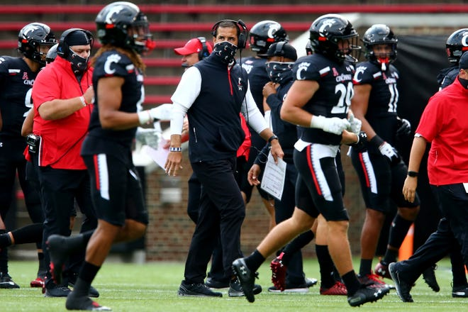 Cincinnati Bearcats head coach Luke Fickell walks back to the sideline as the team takes the field for the opening possession in the first quarter during an NCAA college football game against the Army Black Knights, Saturday, Sept. 26, 2020, at Nippert Stadium in Cincinnati.
