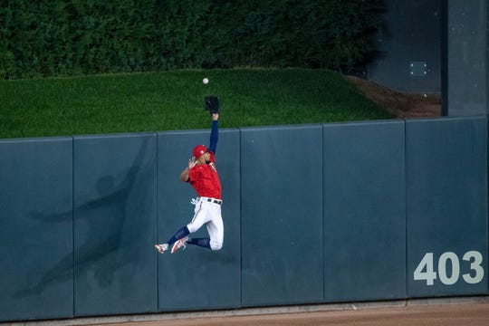 Sep 25, 2020; Minneapolis, Minnesota, USA; Minnesota Twins center fielder Byron Buxton (25) jumps up and attempts to catch a fly ball in the fourth inning against the Cincinnati Reds at Target Field. Mandatory Credit: Jesse Johnson-USA TODAY Sports