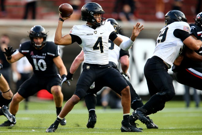 Army Black Knights quarterback Christian Anderson (4) throws in the fourth quarter during an NCAA college football game against the Cincinnati Bearcats, Saturday, Sept. 26, 2020, at Nippert Stadium in Cincinnati. The Cincinnati Bearcats won 24-10.