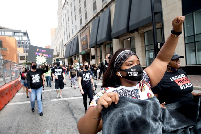 "Eden Robinson, 16, helps lead the ""March for Change"" held by Operation Change Cincy from Fountain Square to the Freedom Center on Saturday, Sept. 26, 2020, in Cincinnati."