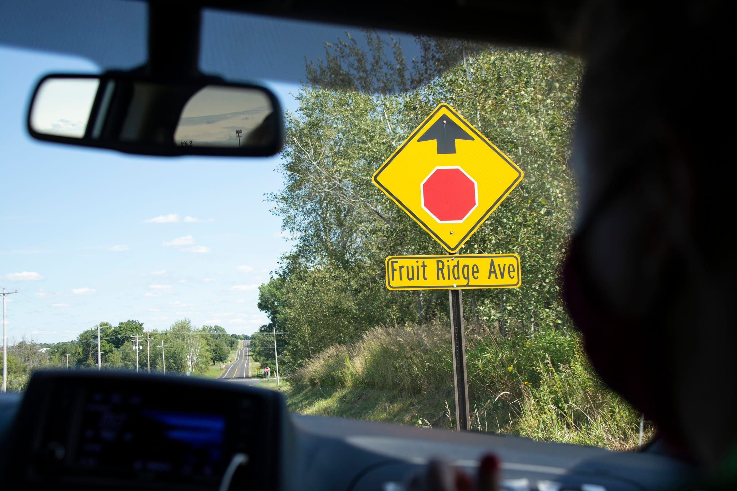 Migrant Legal Aid workers drive to Fruit Ridge near Grand Rapids to do outreach at migrant camps in August.