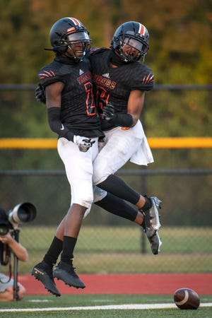 Belleville junior wide receiver Jeremiah Caldwell (2) celebrates a touchdown with junior defensive back Myles Rowser (8) during the high school football game between Dearborn Fordson and Belleville at Belleville High School in Belleville, Mich. on Sept. 25, 2020.