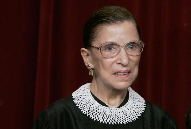 WASHINGTON - U.S. Supreme Court Justice Ruth Bader Ginsburg smiles during a photo session with photographers at the U.S. Supreme Court March 3, 2006 in Washington DC.