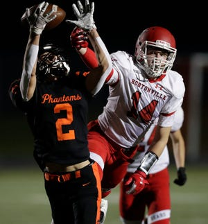 West De Pere's Robert Jones (2) tries to bring in a pass during the 2020 season opener Sept. 25. The Phantoms return to action this week, but they won't be competing for a Bay Conference title.