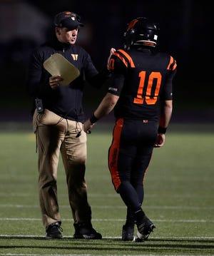 West De Pere coach Chris Greisen talks with quarterback Josh Blount (10) during the season opener against Hortonville on Friday.