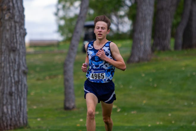 Mac Palmer of the Bison placed fourth overall with a time of 17:17.76 at last year's Great Falls Invitational cross country meet at the Anaconda Hills.