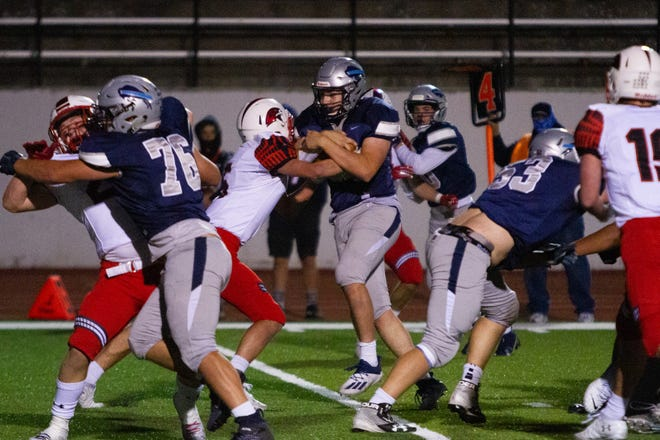 Ryan Krahe runs in the Bison's first and only touchdown, bringing the score to 7-3 after a successful field goal attempt by the Bison. The Great Falls High Bison were defeated by the Bozeman High Hawks 30-7 at the Bison's first home game of the season on Friday, Sept. 25, 2020.
