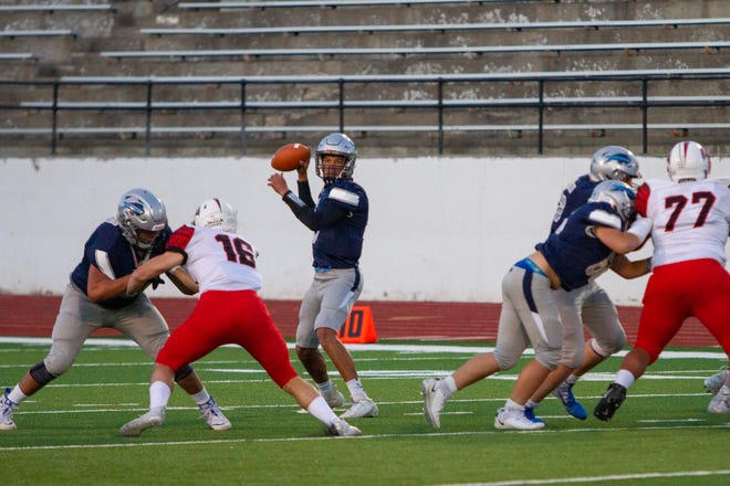 Bison QB Reid Harris looks for a receiver in Great Falls High's loss to Bozeman in Week Three.