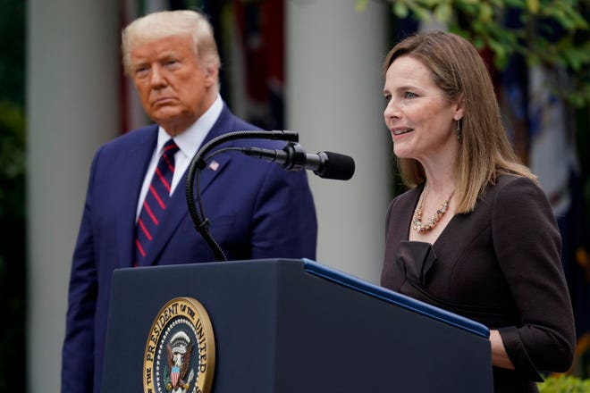 President Donald Trump introduces his Supreme Court nominee, Judge Amy Coney Barrett, at the White House on Sept. 26. Liberals fear the conservative federal appellate judge, a devout Catholic, will vote to reverse Roe v. Wade.