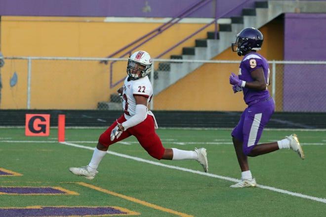 Lafayette Jeff junior Brandon Norton runs for one of his three touchdowns against Marion.
