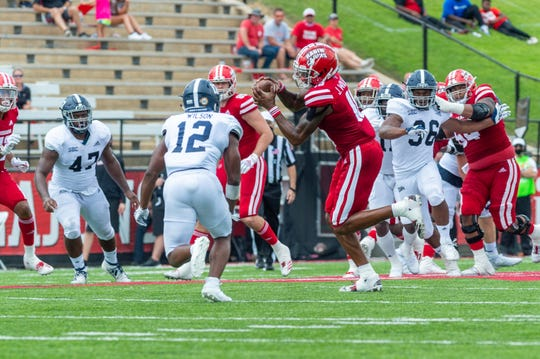 Jalen Williams makes a catch and takes a hard hit from Jav'n Singletary as The Louisiana Ragin Cajuns take down Georgia Southern 20-18 at Cajun Field. Saturday, Sept. 26, 2020.
