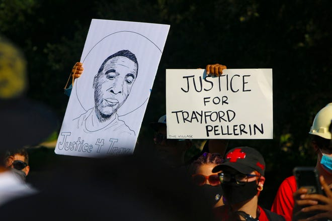 Protesters hold up their signs in Baton Rouge on Friday evening as they hold demonstration against police brutality in front of the Louisiana Governor's Mansion. Among the victims cited by demonstrators was Trayford Pellerin, who was killed by Lafayette police on Aug. 21.