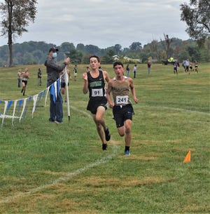 Lancaster sophomore Kaiden Lanoy battles down the back stretch during Saturday's Bob Reall Cross Country Invitational on Saturday. Lanoy was the top Lancaster runner with a fourh-place finish to help lead the Golden Gales to a first-place team finish.