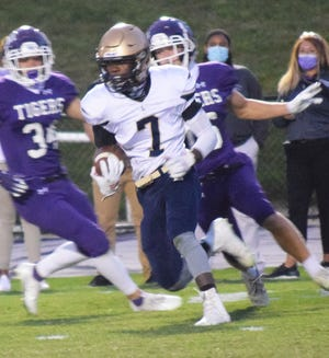 Lancaster's Nasir Robinson runs the ball against Pickerington Central during Friday's Ohio Capital Conference-Buckeye Division game. The Golden Gales lost 35-0.