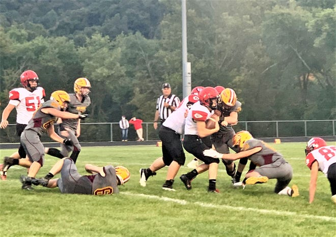Caldwell's Braxton Dudley is tackled by Berne Union's Carson Kellenbarger and Sammy Amnah during Friday's non-conference game. The Rockets suffered their first loss of the season, falling 18-13.