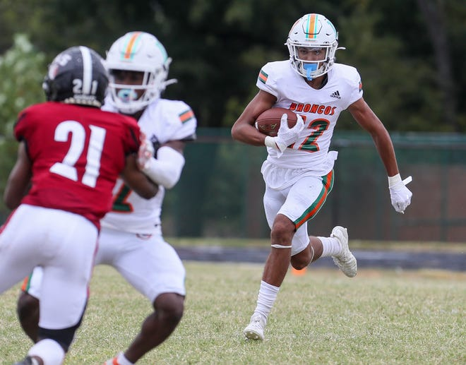 Frederick Douglass' Dane Key finds some open field to gains some yardage in the game against Ballard on Saturday, September 26, 2020.