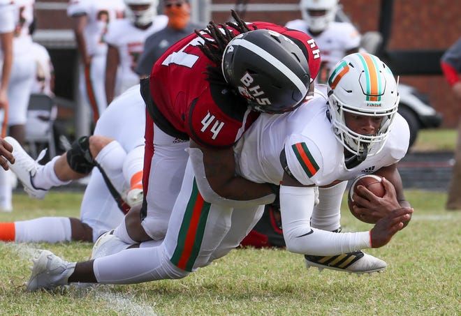 Ballard's Justice Thompson takes down Frederick Douglass' Cameron Dunn in the first half on Saturday, September 26, 2020
