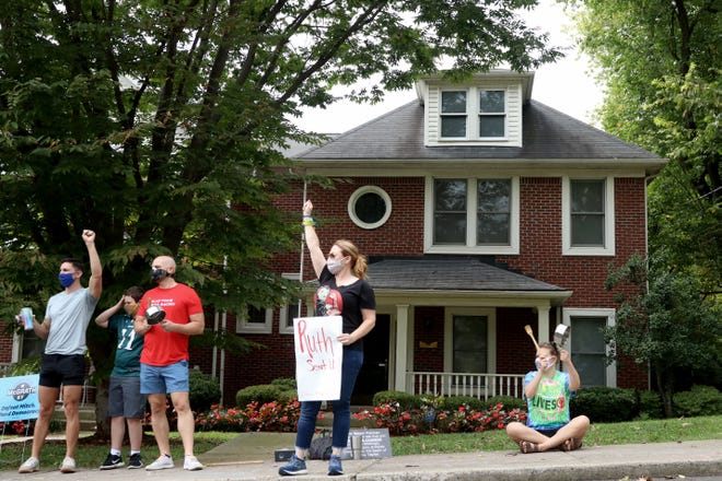 """A small group of protesters gathered outside Sen. Mitch McConnell's house in Louisville, Kentucky, to call on people to """"vote him out."""" Melissa Beckham Born, who lives near McConnell's home, said she and others will be back every Saturday leading up to the November election."""