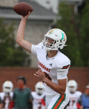 Frederick Douglass quarterback Samuel Cornett passes in the second half of the game against Ballard on Saturday, September 26, 2020.