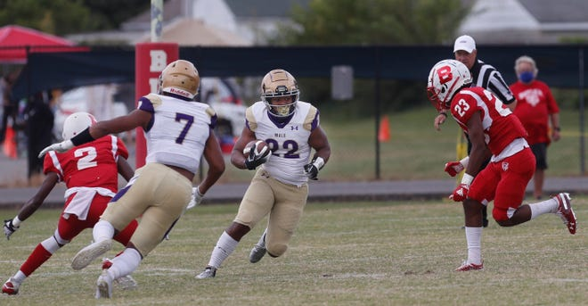 Male's Jaylin Bross makes a move for a first down.09/26/20
