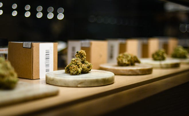"A cabinet with different strains of marijuana buds available at Pleasantrees in East Lansing, the city's first, and so far only facility in East Lansing to receive recreational and medical retailer licenses from the state.  This strain is ""Sour Grape Soda,"" one of their most popular.  The store opened for recreational sales Saturday.  They are tucked in a wooded area near Merritt and Haslett Roads in East Lansing."