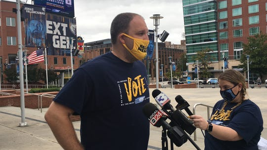 Grizzlies coach Taylor Jenkins addresses media at the team's drive-thru voter education drive outside FedExForum on Saturday