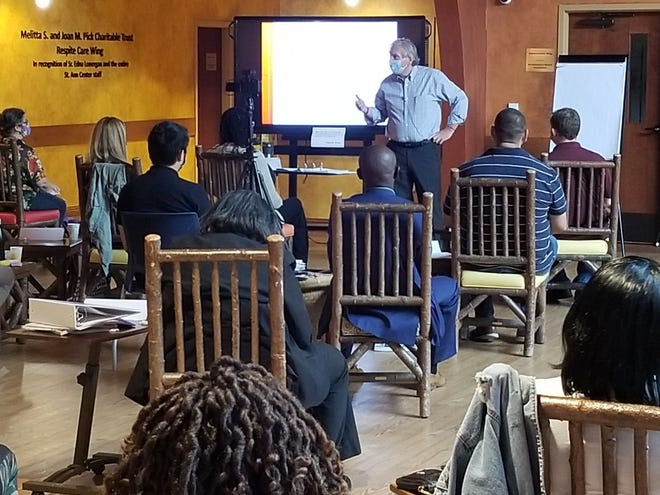 Notre Dame professor Michael Morris speaks at the first session of the BizStarts Institute Community Bootcamp for Entrepreneurs at the St. Ann Center Bucyrus Campus on Saturday.  The program hopes to help low-income entrepreneurs move their businesses  forward.