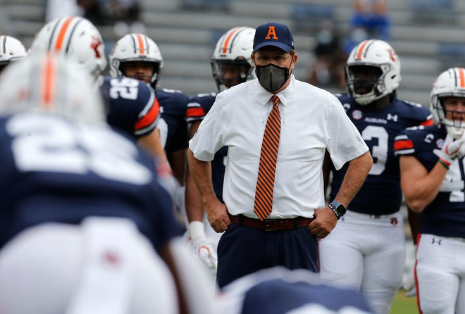 Auburn coach Gus Malzahn watches his team warm up before the game against the Kentucky Wildcats at Jordan-Hare Stadium on Sept. 26, 2020. In honor of late Auburn coach Pat Dye, Malzahn copied Dye's game day attire.