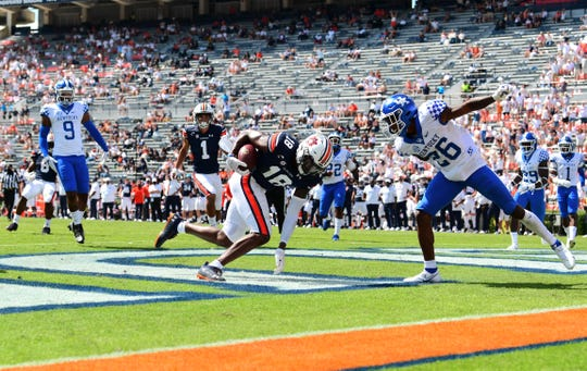Seth Williams scores a touchdown during the first half against Kentucky at  Jordan-Hare Stadium.