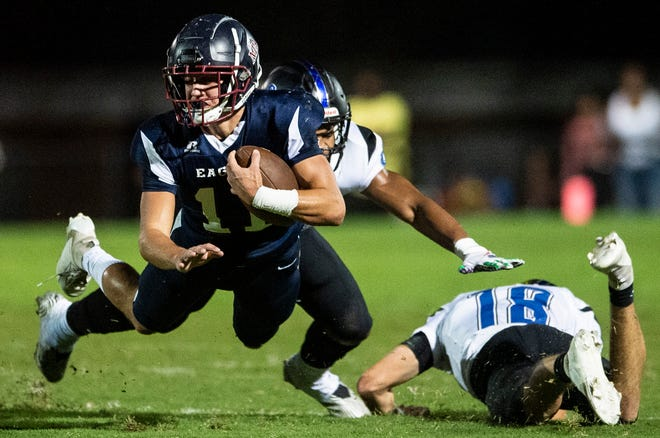 Montgomery AcademyÕs Britton Kohn (11) dives forward for a few extra yards at Montgomery Academy in Montgomery, Ala., on Friday, Sept. 25, 2020. Montgomery Academy leads Catholic 22-8 at halftime.