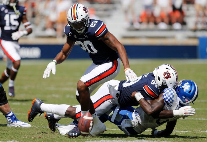 Auburn safety Jamien Sherwood (20) goes for a loose ball after Kentucky quarterback Terry Wilson (3) fumbled during the fourth quarter at Jordan-Hare Stadium on Sept. 26, 2020.