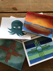 A collection of hand-painted card made by Anelise Elmquist for her business, Art for the World.
