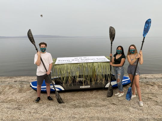 Students Evalyn Garcia, Layton Jones and Clay Jones pose with their three-person kayak. The three students plan to paddle across the Salton Sea on Aug. 26, 2020.