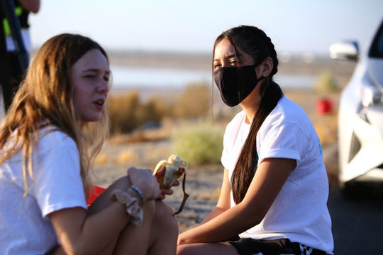 Layton Jones, 17, left, of Palm Desert High School and Evelyn Garcia, 17, of Desert Mirage High School became friends over their shared efforts to raise public awareness of the Salton Sea. The two along with Jones' brother kayaked across the Salton Sea from Desert Shores, Calif., on September 26, 2020.