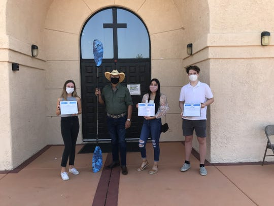 Students Evalyn Garcia, Layton Jones and Clay Jones pose with Riverside County Supervisor V. Manuel Perez. The three students plan to paddle across the Salton Sea on Aug. 26, 2020.