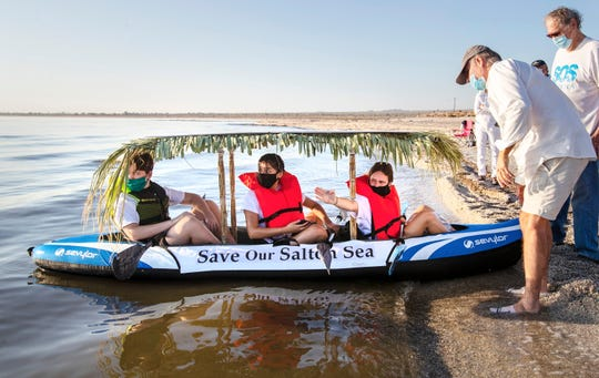 Layton Jones, 17, points toward the direction she, Evelyn Garcia, 17, center, and her brother Clayn Jones, 16, plan to kayak across the Salton Sea to raise awareness for saving the sea. The trio launched their kayak on Saturday morning from Desert Shores, Calif., on September 26, 2020.