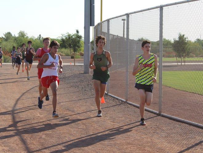 Sept. 25, 2020; Basha High School cross-country junior runner Braydon Lundgren (middle) competes among others in the 5K Men's Junior meet at the Desert Daylight XC Invitational at Mansel Carter Oasis Park in Queen Creek, Ariz.