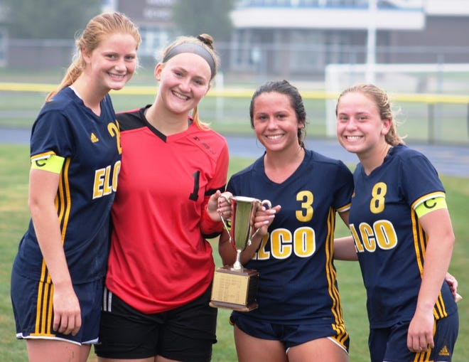 Elco seniors, from left, Shay Miller, Madi Bailey, KK Rueppel and Cassie Johnson pose with the Blue-Gray Cup after Saturday's 1-0 win vs. Cedar Crest.