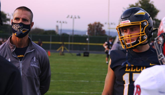 Elco head coach Bob Miller (left) and quarterback Braden Bohannon before Friday night's 40-10 Elco win in Myerstown.