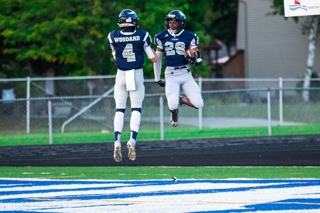 Marysville's Evan Woodard and Lemarcus Lee celebrate a touchdown together against Madison Heights Madison during a Macomb Area Conference-Silver football game on Friday, Sept. 25, 2020.