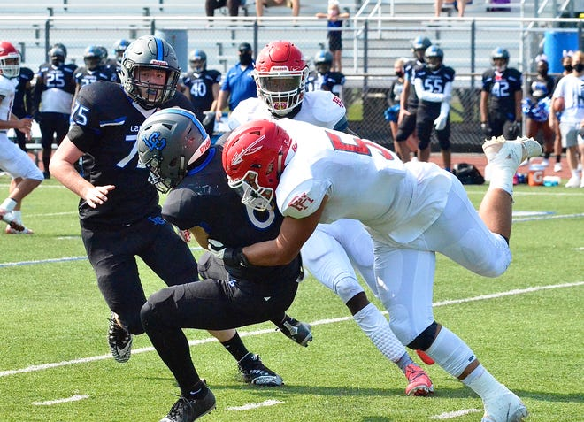 Port Huron's Noah Kindle gets a sack during a Macomb Area Conference-Blue football game on Saturday, Sept. 26, 2020, at L'Anse Creuse.