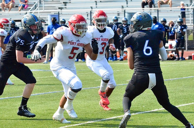 Port Huron's Noah Kindle and Shaka Brown-Thomas chases the quarterback during a Macomb Area Conference-Blue football game on Saturday, Sept. 26, 2020, at L'Anse Creuse.