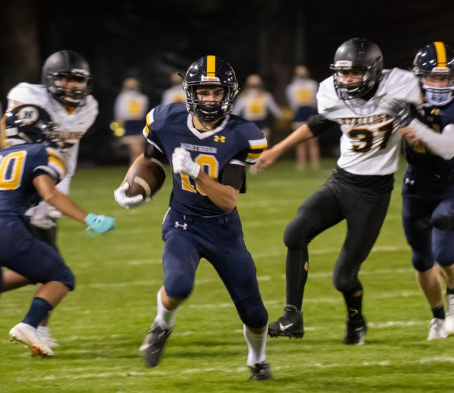 Port Huron Northern's Tyler Houle runs the ball up the sideline during their game last weekend.