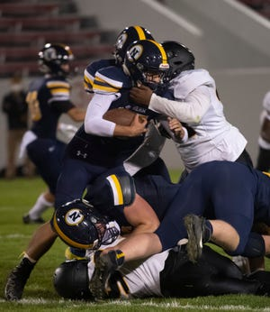 Port Huron Northern's Isaak Ullenbruch runs the ball up the middle during their football game Friday, Sept. 25 at Port Huron Memorial Stadium.