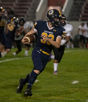 Port Huron Northern's Nick Byrd catches a short pass as he runs up the field during their football game Friday, Sept. 25 at Port Huron Memorial Stadium.