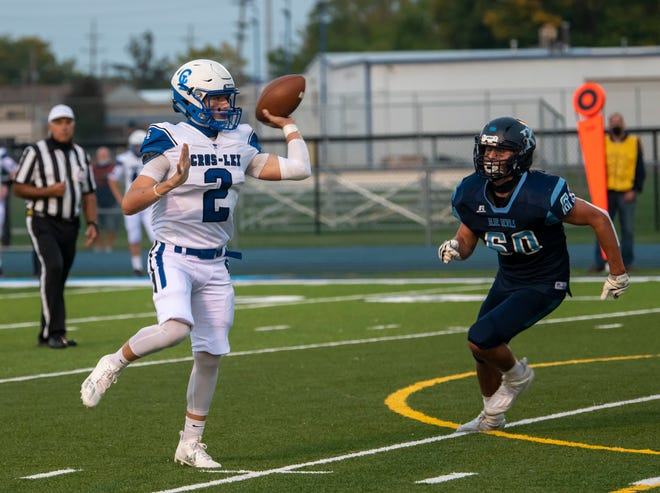 Croswell-Lexington's Jake Townsend throws off balance as Richmond's Reagan Rewalt closes in on him during their football game Friday, Sept. 25 at Richmond.