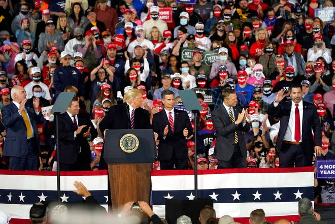 President Donald Trump looks over at Pennsylvania congressional candidate, right, as he speaks at a campaign rally, Tuesday, Sept. 22, 2020, in Moon Township, Pa. (AP Photo/Keith Srakocic)