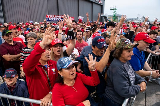 "Supporters of President Donald Trump yell ""four more years"" a few hours prior to the start of a campaign rally on Saturday, September 26, 2020, at Harrisburg International Airport in Middletown, Pa."