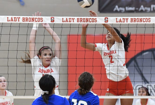 Sonora High School's Alyssa Martinez (2) tips the ball across the net while Kodi Davis covers in a district volleyball match against Odessa Compass Academy Tuesday, Sept. 26, 2020, in Sonora.