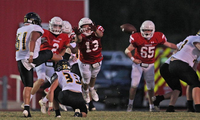 Christoval High School's Beau Jolly (2), Ketcher Joiner (13) and Brock Ratliff (65) try to block a point-after-attempt during a game against Goldthwaite on Friday, Sept. 25, 2020.